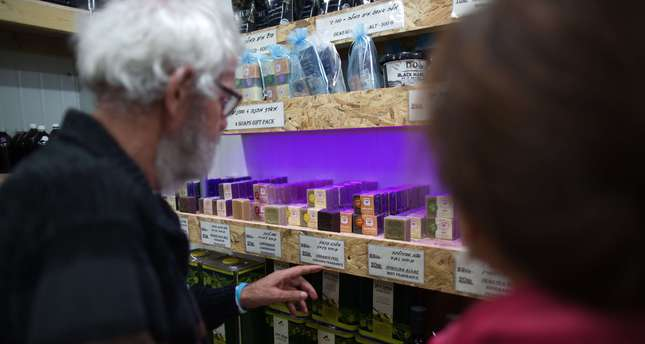 A group of European Christian Dutch visit a show room of soaps produced in a small factory in the Israeli settlement in the occupied West Bank, on November 10 2015. (AFP Photo)