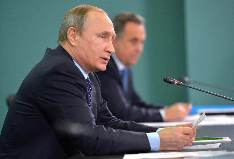 Russian Pres. Putin, left, and Sports Min. Vitaly Mutko, attend meeting with the heads of Russia's sports federations in Sochi, Russia, Wed. Nov. 11. (AP Photo)