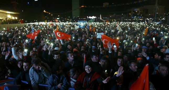 AK Party supporters waving party and national flags as they celebrate their party's victory in the Nov. 1 elections in front the AK Party headquarters in Istanbul.