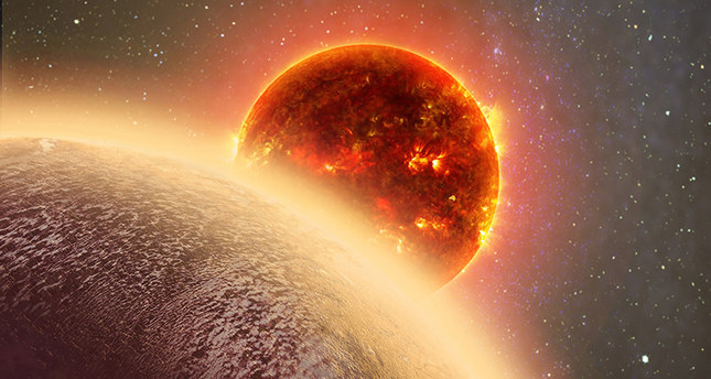 This artist's conception made by Dana Berry of SkyWorks and provided by NASA on Nov. 6, 2015 shows GJ 1132b, foreground, a rocky planet similar to the Earth in size and mass, orbiting a red dwarf star. (AP Photo)