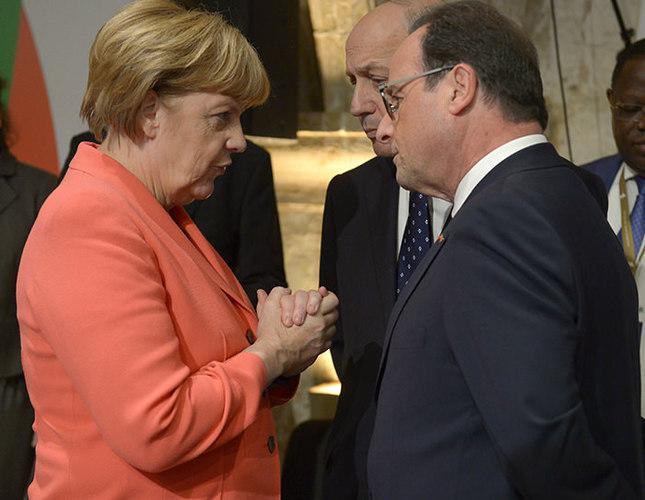 German Chancellor Angela Merkel (Left) with French President Francois HollandeemAFP Photo/em