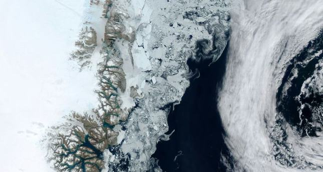 This NASA satellite image released on August 2, 2015 shows the edge of the Zachariae Isstrom glacier on Greenland''s east coast. (AFP Photo)