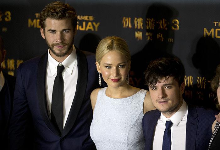 From left to right, Australian actor Liam Hemsworth, U.S. actress Jennifer Lawrence, and U.S. actor Josh Hutcherson (AP Photo)