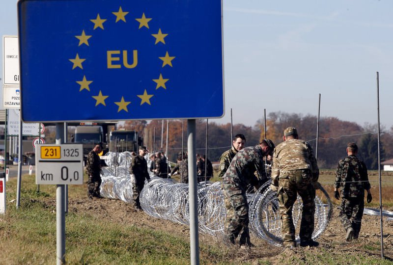 Slovenian soldiers set up wire barriers in the village of Gibina, Slovenia.