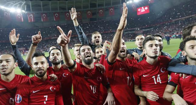 Turkey's players celebrate after winning the EURO 2016 group A qualifying match between Turkey and lceland in Konya, Turkey, Oct. 13. Turkey clinched a place at the Euro 2016.