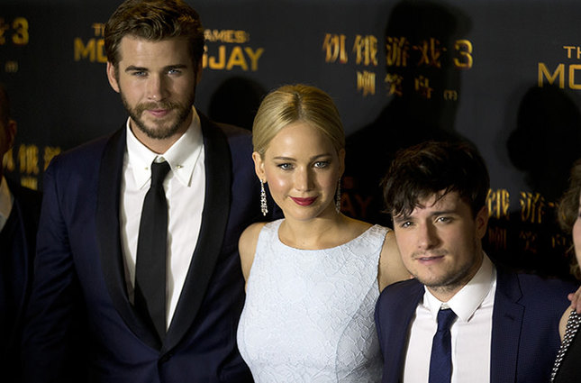 From left to right, Australian actor Liam Hemsworth, U.S. actress Jennifer Lawrence, and U.S. actor Josh Hutcherson AP Photo