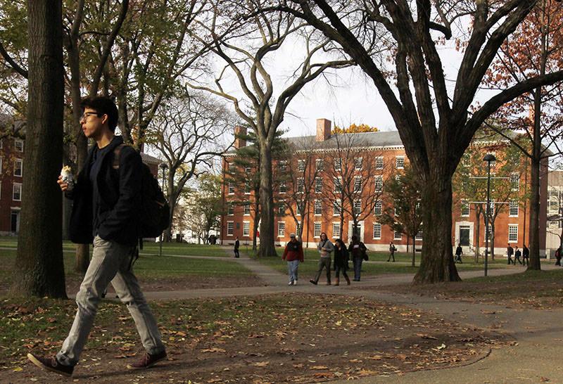 A student walks through Harvard Yard at Harvard University in Cambridge, Massachusetts, in this file photo taken November 16, 2012 (Reuters)