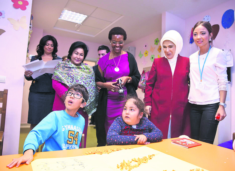 First lady Emine Erdou011fan (2R) visits Du00f6u015femealtu0131 Metropolitan School for Special Education and Rehabilitation Center with the Zimbabwean President's wife Grace Mugabe (C) and Malaysian Prime Minister's wife Rosmah Mansor (L).