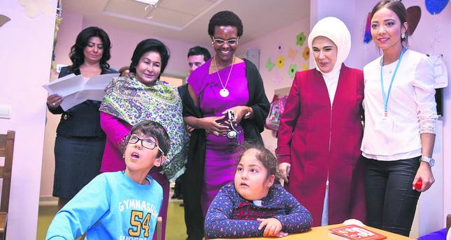 First lady Emine Erdoğan (2R) visits Döşemealtı Metropolitan School for Special Education and Rehabilitation Center with the Zimbabwean President's wife Grace Mugabe (C) and Malaysian Prime Minister's wife Rosmah Mansor (L).
