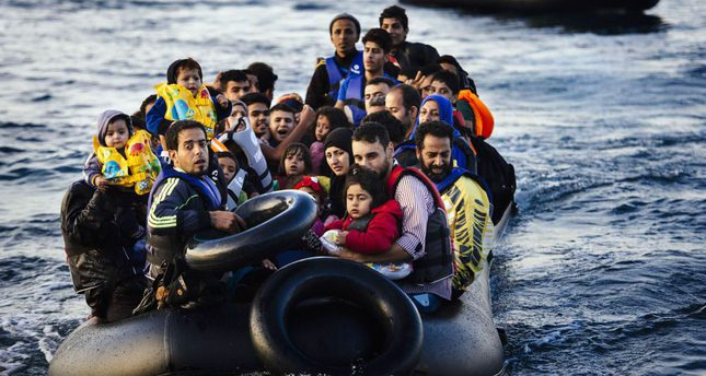 Migrants arrive on a dinghy to the Greek island of Lesbos, after crossing the Aegean Sea from Turkey on Saturday.