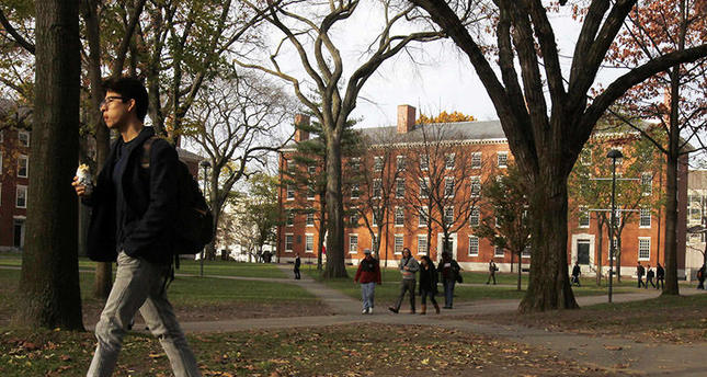 A student walks through Harvard Yard at Harvard University in Cambridge, Massachusetts, in this file photo taken November 16, 2012 (Reuters)