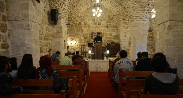 Rev. Ender Peker presides over the first religious service at the church in Mardin's Artuklu district.