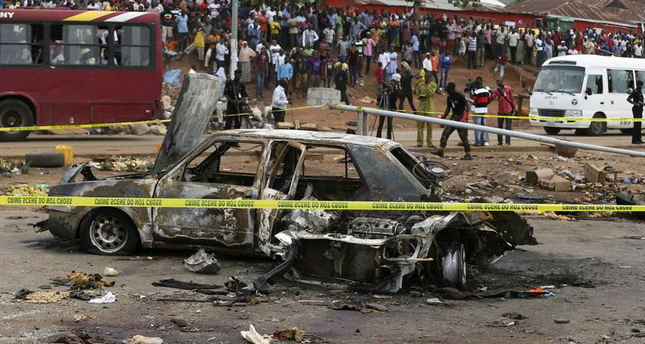 A damaged car is seen at the scene of a car bomb blast in Nyanya, Abuja, Nigeria, May 2, 2014. (Reuters Photo)