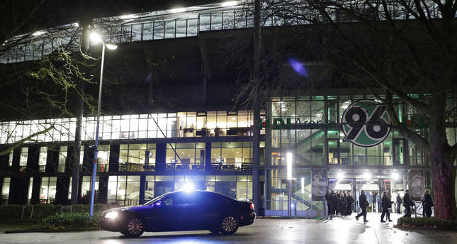 A police car stands in front of the HDI-Arena stadiums as the soccer friendly match between Germany and the Netherlands was cancelled in Hannover, Germany, Tuesday, Nov. 17, 2015. (AP Photo)