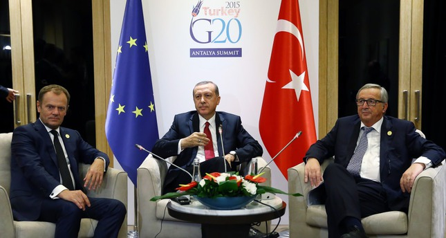 President Erdoğan (C) at a meeting with European Council President Tusk (L) and European Commission President Juncker on Monday.