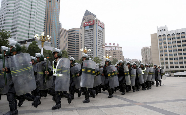 Armed paramilitary policemen run in formation during a gathering to mobilize security operations in Urumqi, Xinjiang Uighur Autonomous Region, China, in this June 29, 2013 file photo. (Reuters Photo)