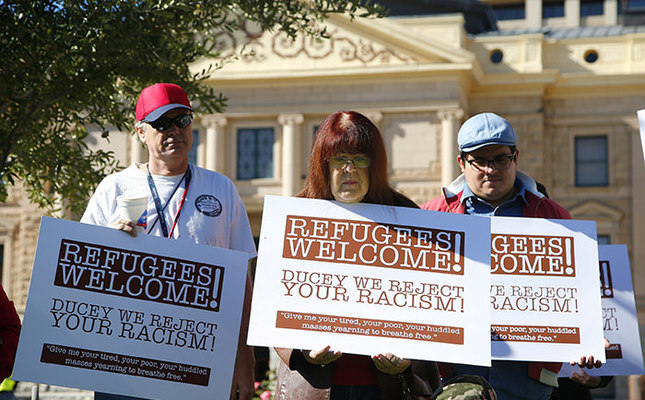 Supporters for the welcoming of Syrian refugees pause during a rally at the Arizona Capitol Tuesday, Nov. 17, 2015, in Phoenix. (AP Photo)