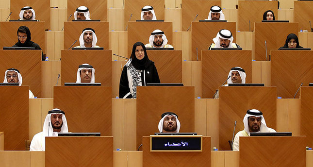 Amal Al Qubaisi (C, standing) takes the oath as a council member before being elected as speaker of the UAE Federal National Council (FNC), during the inaugural session of the new FNC (EPA Photo)