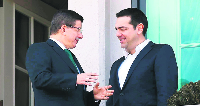 Prime Minister Ahmet Davutoğlu (L) speaks with his Greek counterpart Alexis Tsipras prior to a meeting in Ankara on Wednesday.