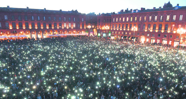 People gather at Capitol Square in Toulouse, southern France, to pay tribute to the victims of the Paris attacks.