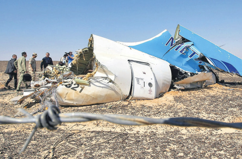 Russian Emergency Minister Vladimir Puchkov (4th L) at the crash site of a A321 Russian Metrojet airliner in Wadi al-Zolomat, a mountainous area of Egypt's Sinai Peninsula.