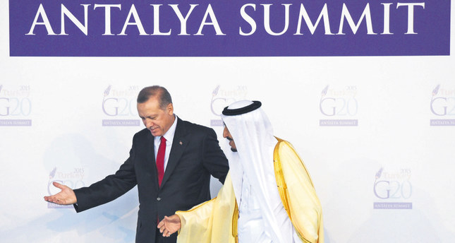 President Erdogan (L) greets Saudi King Salman during the official welcome ceremony at the G20 Leaders Summit on Nov. 15 in Antalya.