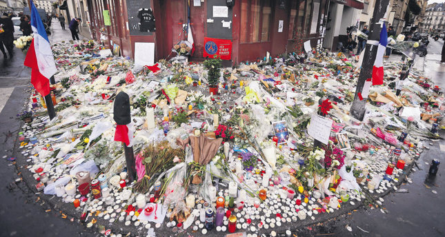 Flowers and candle tributes are placed at the Restaurant Le Carillon in Paris, after last Friday's attacks.