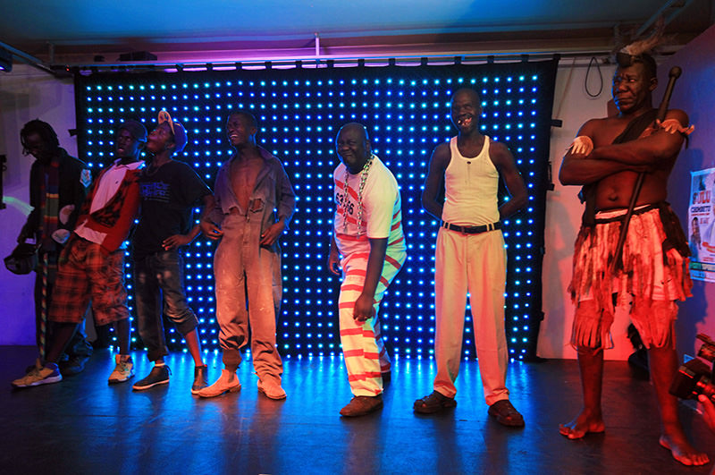 Contestants stand on stage, during the 2015 edition of the Mr Ugly competition, in Harare, Saturday, Nov. 21.2015 (AP Photo)