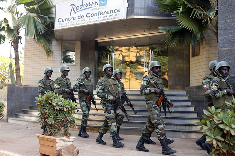 Soldiers from the presidential guard patrol outside the Radisson Blu hotel in Bamako, Mali, Saturday, Nov. 21, 2015, in anticipation of the President's visit (AP photo)