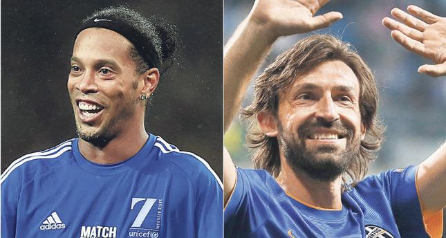 Ronaldinho (L) and Pirlo