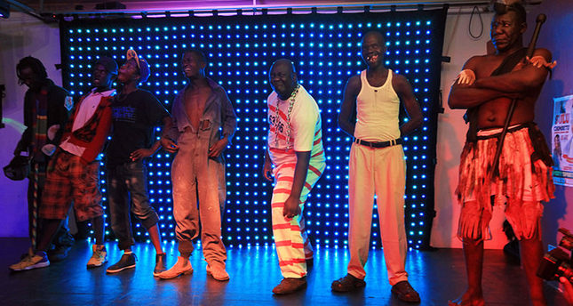 Contestants stand on stage, during the 2015 edition of the Mr Ugly competition, in Harare, Saturday, Nov. 21.2015 AP Photo