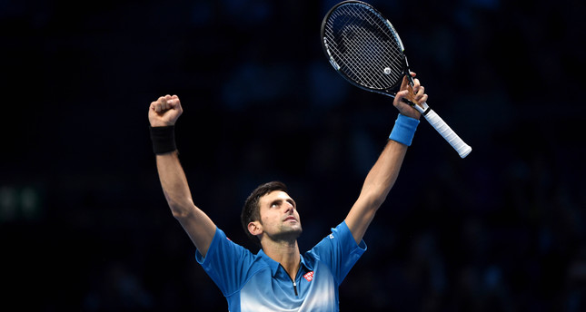 erbia's Novak Djokovic celebrates following his two set win over Spain's Rafael Nadal during their semi final match at the ATP Tour tennis finals. (EPA Photo)