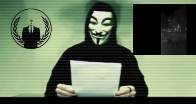 A man wearing a mask associated with Anonymous makes a statement in this still image from a video released on social media on November 16, 2015. (Reuters Photo)