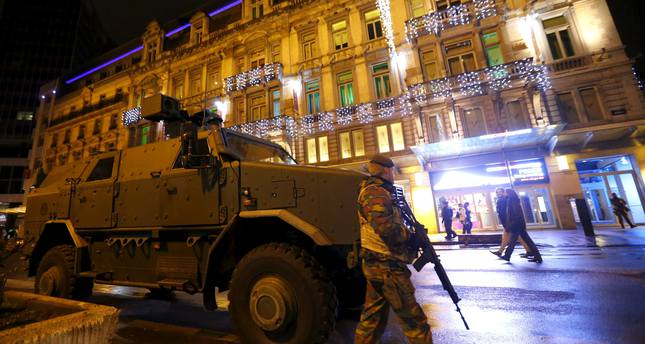 A Belgian soldier patrols near an armoured vehicle in central Brussels November 22, 2015, after security was tightened in Belgium following the fatal attacks in Paris. (Reuters Photo)