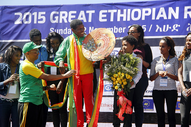 Gebrselassie received a plaque and made a speech following the event. (AA Photo)