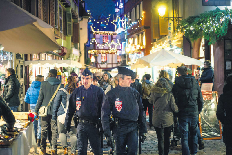 French CRS police officers (Republican Security Companies) patrol the Colmar Christmas market following the terror attacks in Paris.