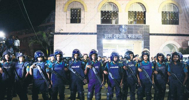 Bangladeshi police officers stand guard at Dhaka's Central Jail.