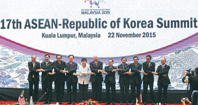 South Korea President Park Geun-hye (C) poses for a photo with ASEAN leaders during the 17th ASEAN-Republic of Korea Summit at the 27th ASEAN summit in Kuala Lumpur, Malaysia.