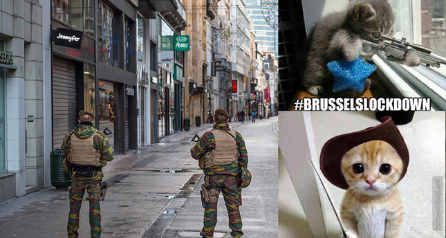 Belgian soldiers patrol in Rue Neuve, the busiest shopping street in Brussels, now empty, 22 November 2015 (EPA photo)