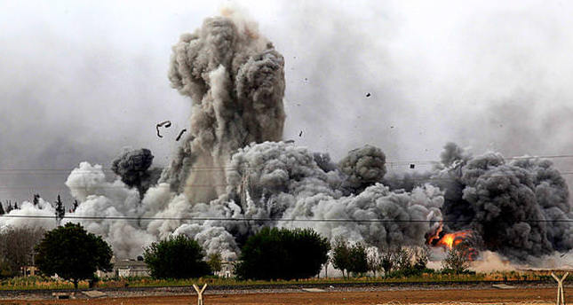 A file photo shows the moments immediately after a US-led airstrike on Daesh positions. (AFP Photo)