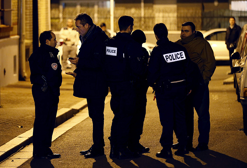 French police officers stand guard in a street after an explosive vest without detonator was found (EPA Photo)
