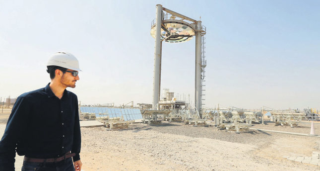 An employee walks at a solar plant in Masdar outside the Emirate of Abu Dhabi.