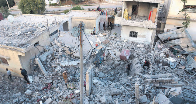 Residents inspect a site claimed to be damaged by the airstrikes of the Russian air force in Nawa city, Deraa, Syria