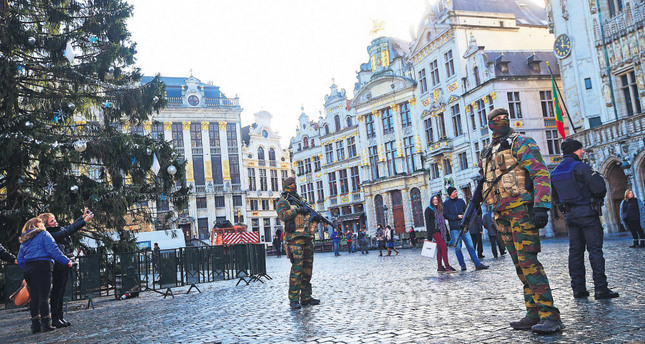 Brussels began a third consecutive day in lockdown under maximum terror alert after Belgian police staged a series of raids but failed to find a key suspect of the Paris attacks.