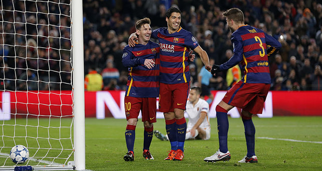 Barcelona's Gerard Pique (R), celebrates with Lionel Messi (L) and Luis Suarez (C) after he scored his team's 4th goal during the Group E Champions League soccer match between Barcelona and Roma at the Camp Nou in Barcelona, Spain. (AP Photo)