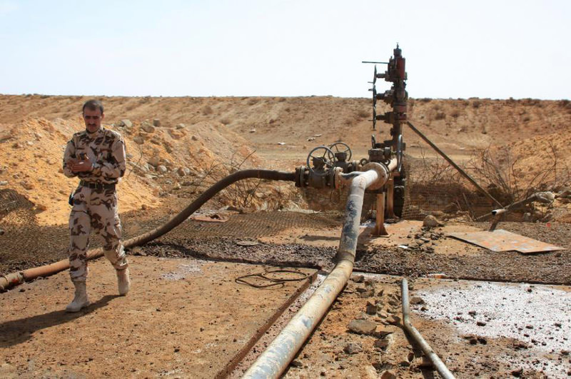 A member of the Syrian army u0131nspects the jazal oil field after fierce battles with Daesh.