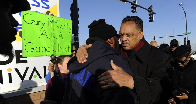 Rev. Jesse Jackson right, hugs Fred Hampton Jr., left, after a vigil for 17-year-old Laquan McDonald, who was fatally shot and killed Oct. 20, 2014 in Chicago. (AP Photo)