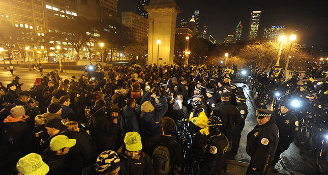 Chicago Police form a line to keep a protest for 17-year-old Laquan McDonald from entering Grant Park, early Wednesday, Nov. 25, 2015 (AP Photo)