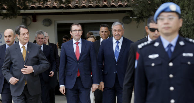 Greek Cyprus president Anastasiades, left, Turkish Cypriot leader Akıncı, right, and United Nations envoy Espen Barth Eide, center, leave Nicosia airport in Cyprus, Wednesday, Nov. 25, 2015 (AP Photo)