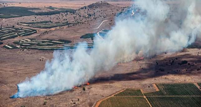 A still image from video footage shown by the HaberTurk TV Channel shows smoke billowing from the crash site of a plane after it was shot down near the Turkish-Syrian border, 24 November 2015. (Photo: EPA/HABERTURK TV CHANNEL)
